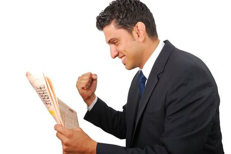 Businessman rejoicing with success while reading the newspaper Stock Photo - 5276226