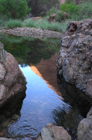 Water reflection of the rocks in the blue water, NT, Australia