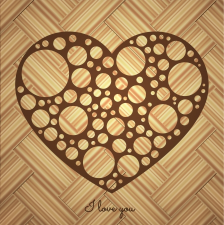wholes: Perforated heart on a wooden background