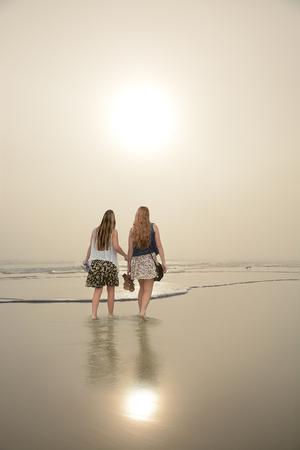 Friends relaxing on beautiful foggy beach at sunrise, Daytona Beach, Florida, USA. Stok Fotoğraf