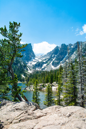 Early summer landscape with lake  and snow covered mountains.  Dream Lake, Rocky Mountains National Park, Colorado, USA.