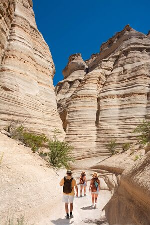 Beautiful mountain scenery. Family exploring New Mexico on summer vacation. People with backpacks hiking in the mountains. Kasha-Katuwe Tent Rocks National Monument, Near Santa Fe, New Mexico, USA Stok Fotoğraf