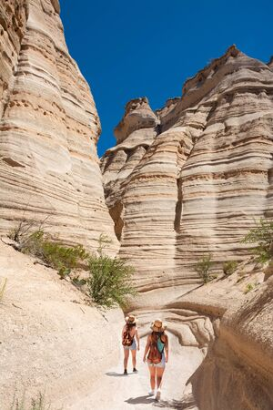 Beautiful mountain scenery. Girls exploring New Mexico on summer vacation. People with backpacks hiking in the mountains. Kasha-Katuwe Tent Rocks National Monument, Near Santa Fe, New Mexico, USA Stok Fotoğraf