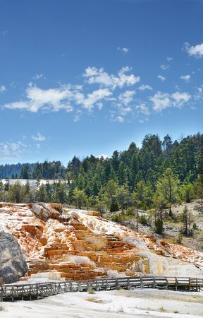 Beautiful landscape. Mammoth Hot Springs on a hill of travertine in Yellowstone National Park. Blue sky in the background. Copy space. Wyoming,USA. Stok Fotoğraf