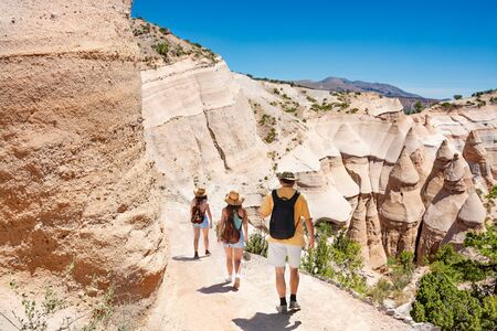 People on summer vacation hiking trip. Family on hiking trip in beautiful mountains. Kasha-Katuwe Tent Rocks National Monument, near to Santa Fe, New Mexico, USA
