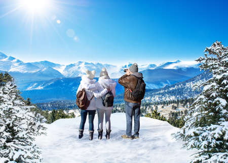Family enjoying beautiful  mountain view on winter  hiking trip. People on winter vacation. Rocky Mountain National Park. Close to Estes Park, Colorado, USA