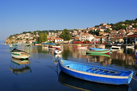 Fishing boats with the view of an old town of Ohrid in the background