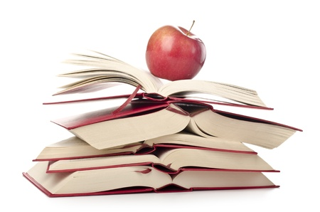 reference book: Stack of books with apple; back to school or university or college; learning; education Stock Photo