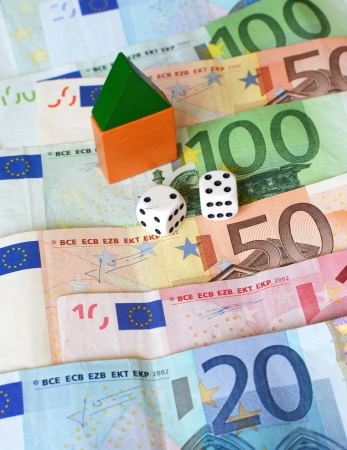 Real estate finance concept with mini house, dice and Euros  Gambling  photo
