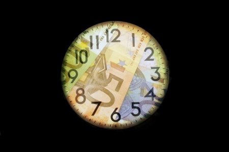 coins shot in golden color: Time is money  Finance system concept
