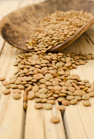 Lentil seeds on wooden table photo