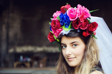 Portrait of a beautiful young woman outdoors with flower turban on her head Stock Photo