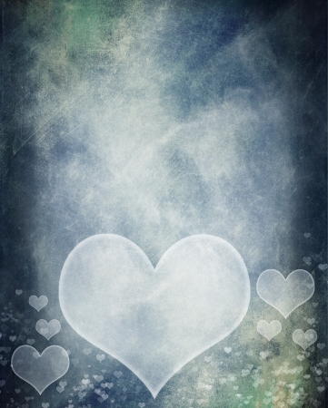 Grunge hearts over blue textured background photo