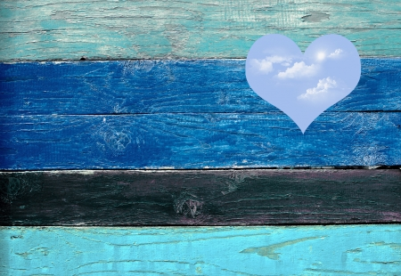blue sky hole in a wooden wall background