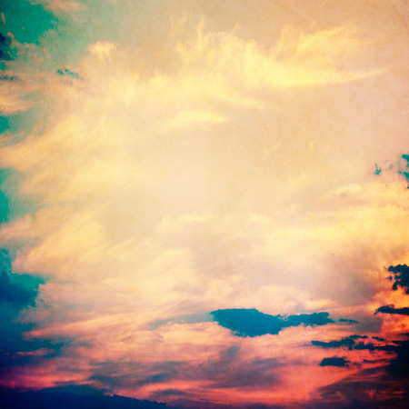 cross processed: clouds on a textured vintage paper , with grunge stains Stock Photo