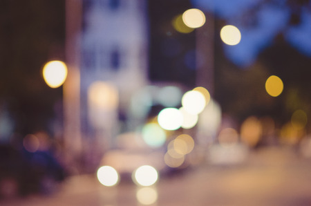 blurry lights: beautiful background of bokeh lights at night on road with car Stock Photo