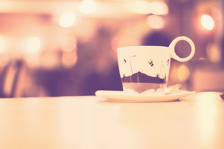 out of focus: Coffee cup in coffee shop - vintage style effect picture