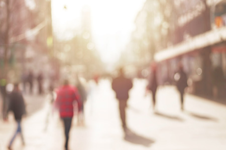 woman street: City commuters. Abstract blurred image of a city street scene. Stock Photo