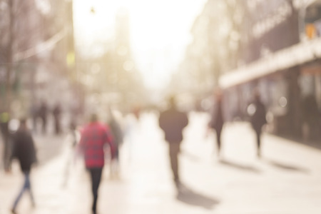 street: City commuters. Abstract blurred image of a city street scene. Stock Photo