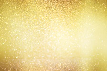 Zusammenfassung defokussiert Lichter, Schaumwein Urlaub Bokeh Hintergrund mit goldenen Tönen, elegant weihnachten Hintergrund