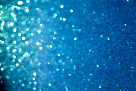 brilliant: glitter vintage lights background.silver, blue and black. de-focused.