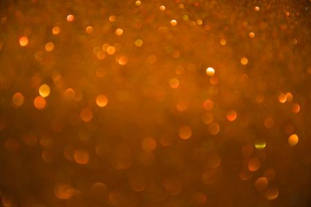 Gold spring or summer background. Elegant abstract background with bokeh defocused lights