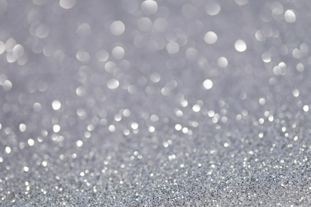 Silver glittering christmas lights. Blurred abstract background