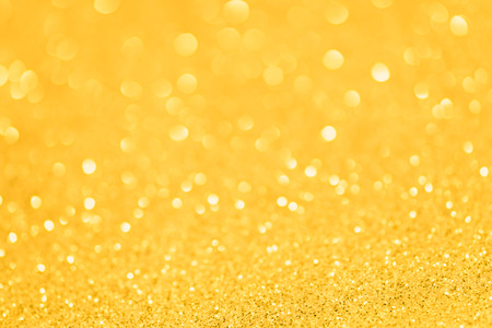 Yellow golden glittering Christmas lights. Blurred abstract background Archivio Fotografico