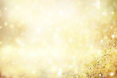 oro: Resumen de antecedentes de vacaciones, hermosas luces brillantes de Navidad, la magia bokeh brillante. Foto de archivo