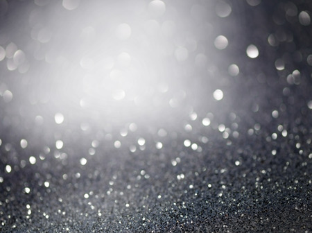 glitzy: lSilver glittering christmas lights. Blurred abstract background
