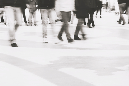 multiple exposure: abstract photo of people in motion, multiple exposure effect.Blurred people walking through a city street.