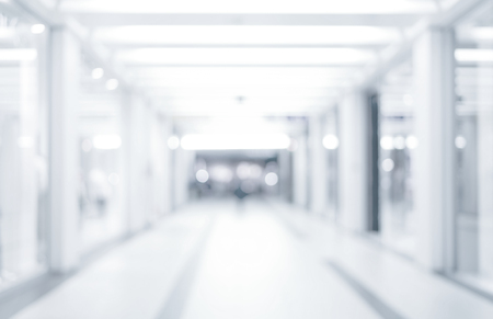 blurred background: abstract defocused blurred background, empty business corridor or shopping mall. Medical and hospital corridor defocused background with modern laboratory clinic