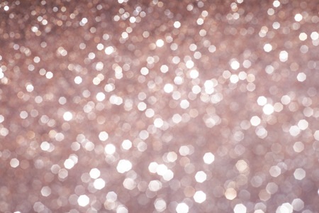 christmas gold: abstract defocused lights, sparkling holiday bokeh background with golden tones, elegant christmas backdrop