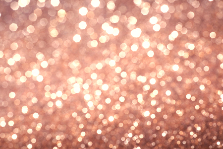 glimmering: abstract defocused lights, sparkling holiday bokeh background with golden tones, elegant christmas backdrop