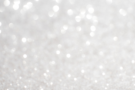 white  background: Silver white glittering Christmas lights. Blurred abstract background