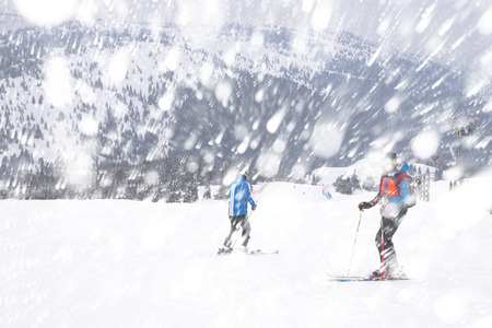serbia xmas: unrecognizable people skiing in the snow in the winter