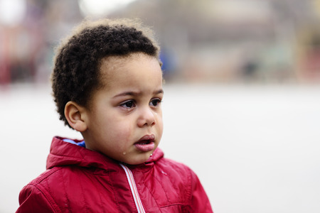 Portrait of a little upset toddler boy crying.