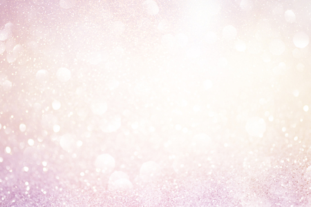 pale pink glittering christmas lights. Blurred abstract background Stock Photo