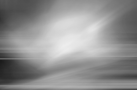 digitally generated image of white light and stripes moving fast over black background