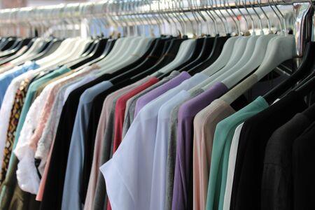 cotton clothes hanging outside a shop