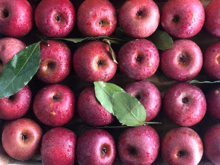 fresh apple fruit pile in a fruit shop
