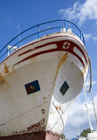 prow: The prow of a ship in a shipyard, against a bright sky. Stock Photo