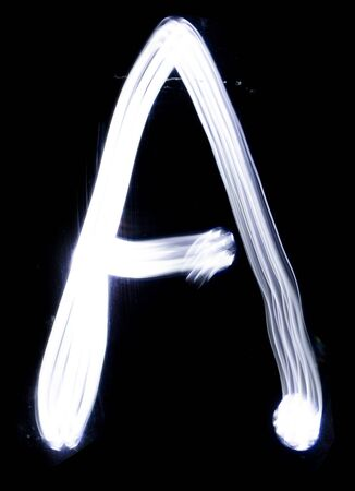 Handwrite letter A, made with light painting technic isolated on black. Light effect font of full alphabet set of upper case letters. Stock fotó