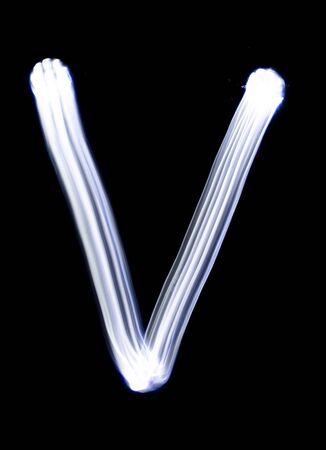 Handwrite letter V, made with light painting technic isolated on black. Light effect font of full alphabet set of upper case letters.