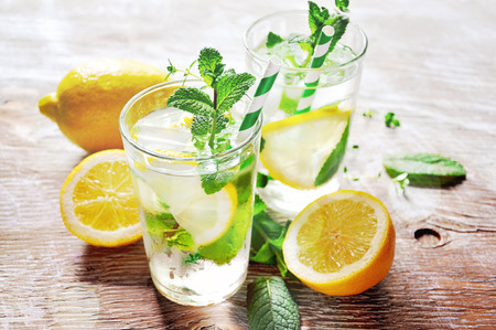 water on leaf: Iced mint tea with lemon and ice cubes