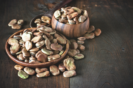 fava: Fava beans in wooden bowls. Rustic style. Toned image. Selective focus Stock Photo