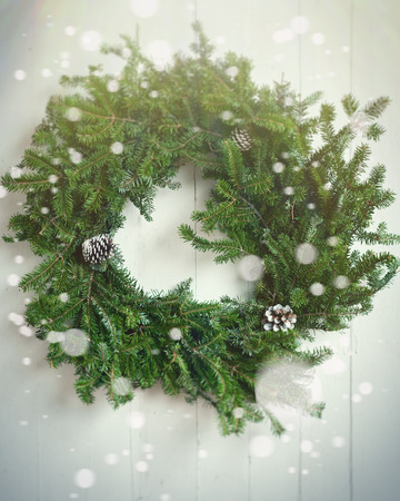 Christmas fir wreath on wooden background. Toned image. Tilt-shift lens effect. Defocused effect. Copy space. Stok Fotoğraf