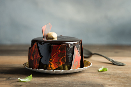 Pastry, dessert, chocolate cake. Rustic background. Toned, selective focus