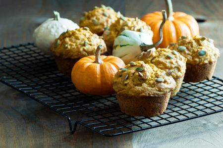 Pumpkin muffins, baking healthy vegan snack, Thansgiving and autumn dessert, selective focus, toned image 免版税图像
