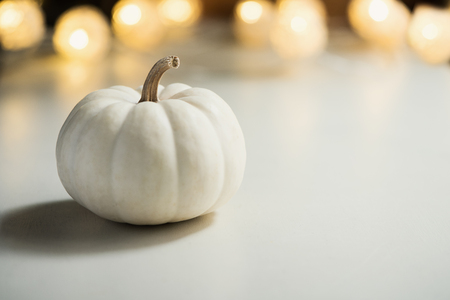 Pumpkins or white gourds. Fall or autumn festive background. Thanksgiving. Selective focus, copy space 免版税图像